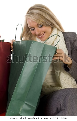 Happy Shopper Looking In Carrier Bag Stock photo © stryjek