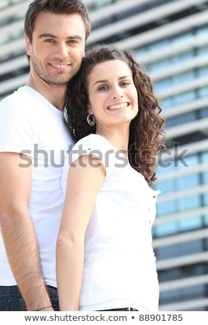 Couple stood outside modern office block Stock photo © photography33