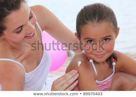 mother putting suncream on her daughter stock photo © photography33