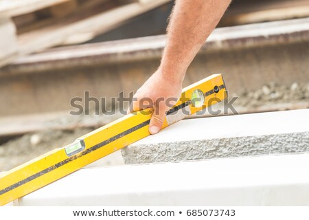 construction worker with a spirit level stock photo © photography33