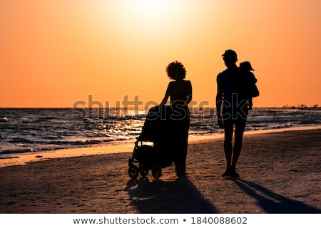 Silhouette of the young woman on a gulf on a sunset Stock photo © acidgrey