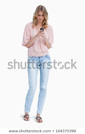 mérges · nő · áll · néz · mobiltelefon · fehér - stock fotó © wavebreak_media