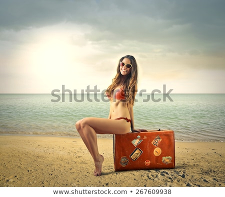 Teen girl seating at a beach Stock photo © AndreyKr