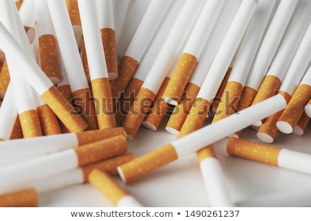 cigarettes arranged in a row a background stock photo © stockyimages