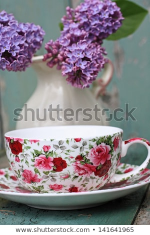 Stock photo: Beautiful lical and a cup of tea