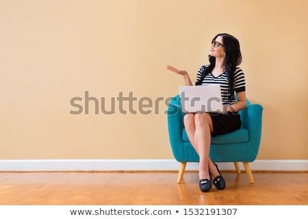 Genç güzel bir kadın sandalye iş oda Stok fotoğraf © wZrokowiec