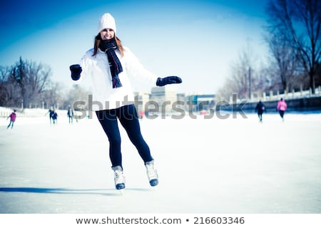 Attractive woman with ice skates Stock photo © ivonnewierink