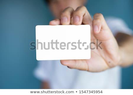 Businessman holding blank credit card Stock photo © stevanovicigor