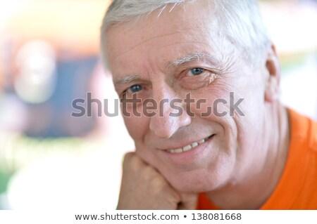 Senior man glimlachend hand kin oude man Stockfoto © bmonteny