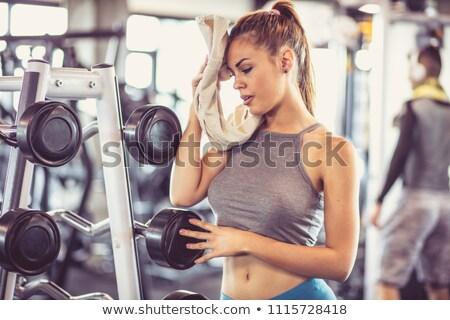Mujer sudar toalla mujer de la aptitud agua nina Foto stock © trendsetterimages