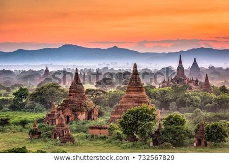Pagode paisagem Mianmar birmânia árvores nascer do sol Foto stock © smithore