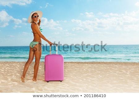 fiatal · nő · fürdőruha · sétál · tengerpart · nyári · vakáció · turizmus - stock fotó © dolgachov