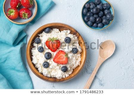 Fresh strawberry on wooden bowl Stock photo © nalinratphi