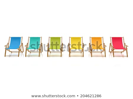 White beach chair in front of a pool stock photo © jrstock
