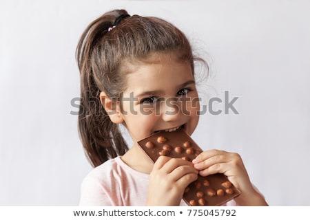 Little cute kid eating chocolate Stock photo © zurijeta