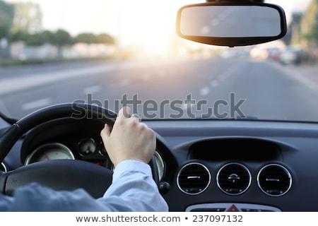 Businessman with steering wheel Stock photo © cherezoff