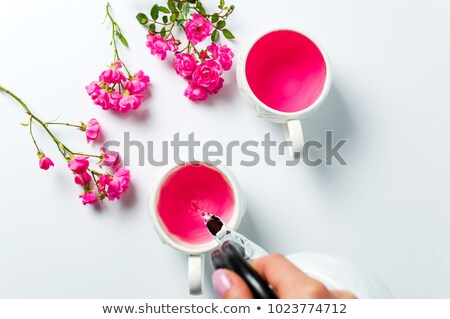 A pot with fresh flowers Stock photo © bluering