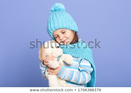cute little girl with her favourite stuffed toy stock photo © giulio_fornasar