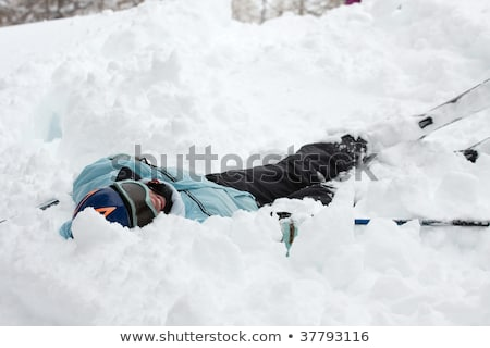 Laughing woman lays in fallen snow Stock photo © IS2