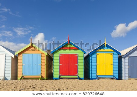 Stok fotoğraf: Row Of Colorful Beach Huts On Beach