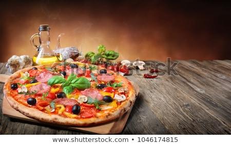 tasty pizza with olives stock photo © ssuaphoto