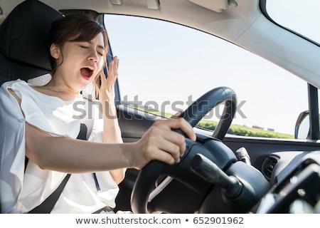 Kadın içinde araba yandan görünüş genç kadın Stok fotoğraf © AndreyPopov