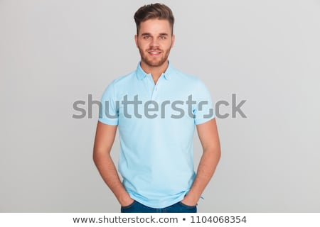 portrait of relaxed casual man holding neck and smiling stock photo © feedough