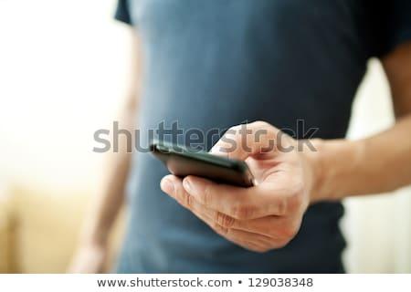 Közelkép kezek sms chat okostelefon barátok kéz Stock fotó © Kzenon