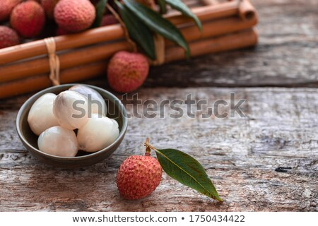 Closeup of ripe exotic lychee fruit on gray background with copy space. Focus stacking, fullsize 50  Stock photo © artjazz