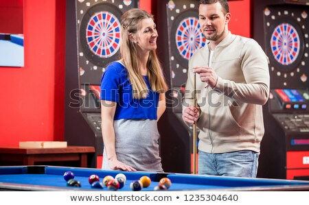 Wife looking at husband while playing billiard Stock photo © Kzenon