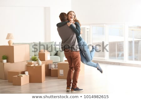 happy couple hugging at new home Stock photo © dolgachov