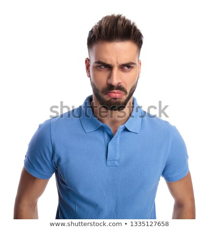 Dissapointed young man looking at a side Stock photo © feedough