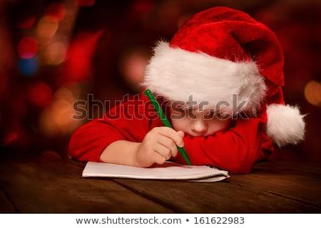 christmas holidays boy writing letter to santa stock photo © robuart