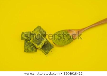 spoon with matcha powder and candy made of matcha on yellow background homemade matcha stock photo © galitskaya