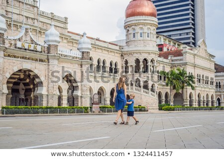 Mom and son on background of Sultan Abdul Samad Building in Kuala Lumpur, Malaysia. Traveling with c stock fotó © galitskaya
