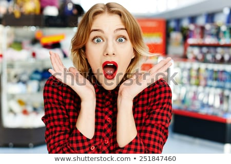 Surprised shopper red-haired woman Stock photo © rogistok