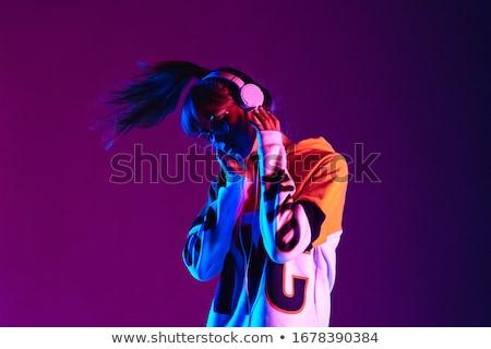 gyönyörű · lány · mosolyog · zenét · hallgat · lány · fejhallgató · nő - stock fotó © dolgachov