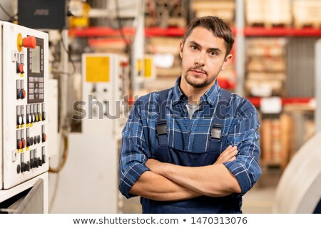 Young professional technician or engineer of large processing factory Stock photo © pressmaster