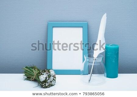 Menina azul flores buquê branco parede Foto stock © serdechny