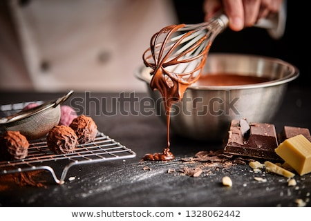 chef making chocolate at confectionery shop Stock photo © dolgachov
