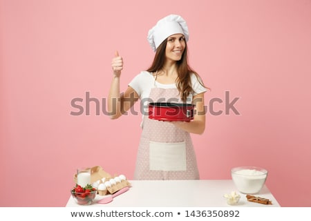 A woman with baked pastry pies in the kitchen at Christmas time Stock photo © lovleah