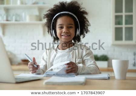 happy little african american girl with book stock photo © dolgachov