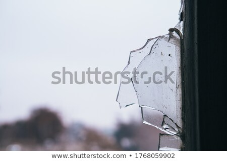 Close up of broken windows in a derelict building. Stock photo © latent