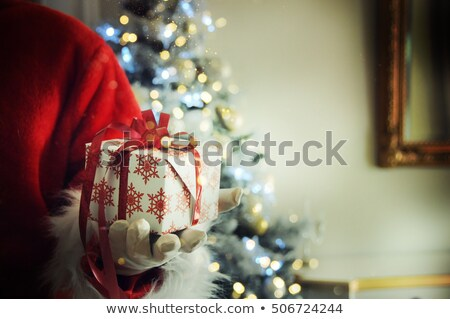 Santa's hand holding colorful bags Stock photo © AndreyKr