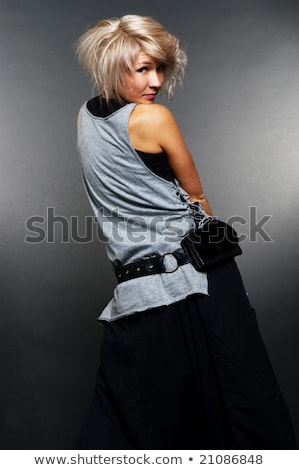 Glamorous girl turning back and looking at you Stock photo © stockyimages