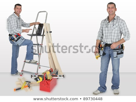Stock photo: duo of twin carpenters at work