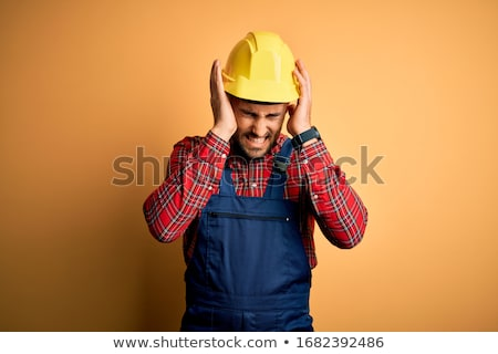 Builder suffering from tension headache Stock photo © photography33