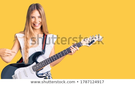 young blonde with an electric guitar stock photo © acidgrey