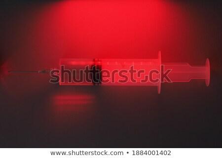 Seringa sinal vermelho azul luz medicina vermelho Foto stock © luckyraccoon