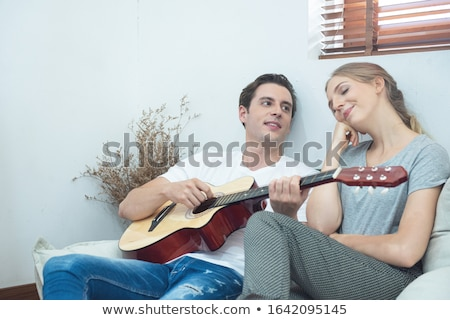 Couple with guitar Stock photo © photography33